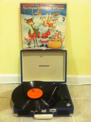 "November 20. This sweet record player-inside-of-a-suitcase that my friends Susan and Kara gave me for my birthday last year. Shown here also is the greatest Christmas album of all time: the original ""Rudolph the Red-Nosed Reindeer"" tv special soundtrack, found at Sal's Army for two bucks!"